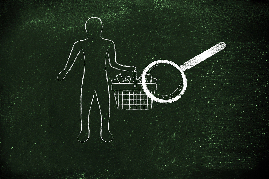 magnifying glass analyzing client's shopping cart full of items, analyze customers' needs